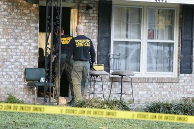 Boy defends home in shootout; suspect dies 13-year-old grabbed mother's gun when 2 tried to break in, police say