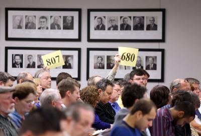 Bidders battle for bargains Investors crowd delinquent property-tax sale (copy)