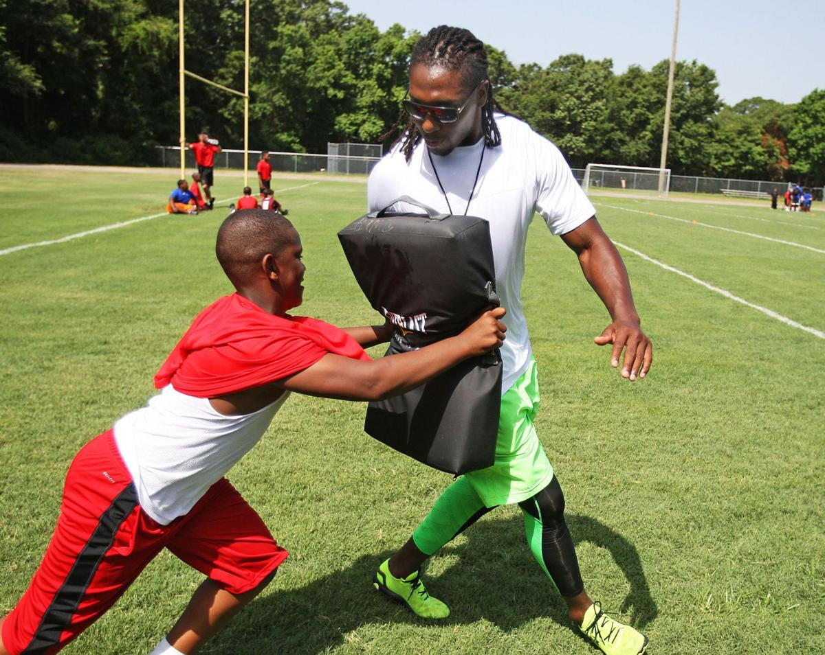 Lowcountry's 'true ambassador' Falcons White comes home for annual youth football camp