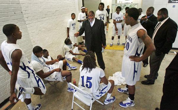 Burke coach gets job back