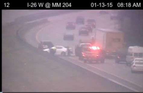 Wreck on I-26 eastbound blocking two left lanes near 205 mile marker