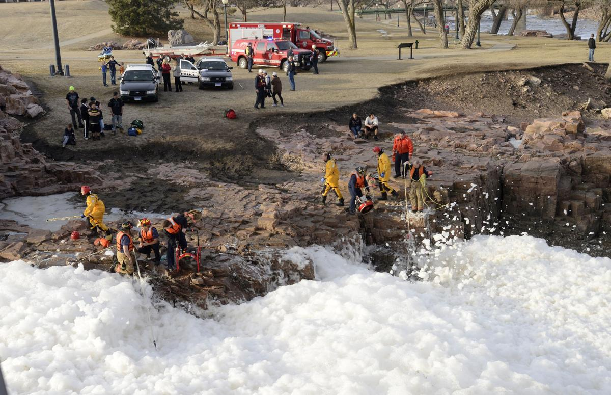 Crews hunt for bodies in icy South Dakota river