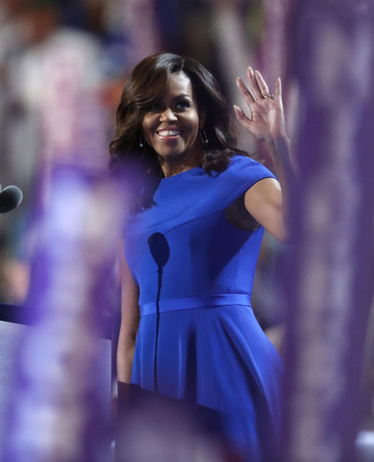 After disputes, Michelle Obama electrifies Dem convention