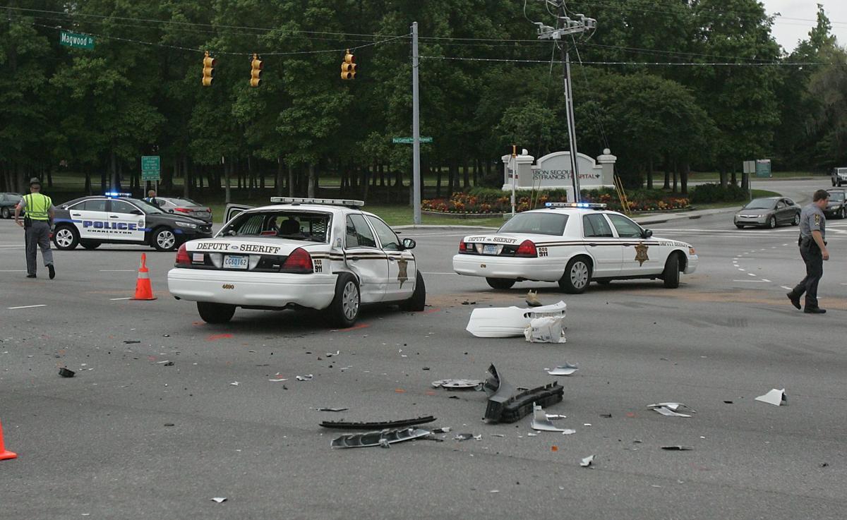 Fault placed on deputy in West Ashley crash Deputy, motorist, dog hurt Video shows West Ashley crash involving Charleston County deputy