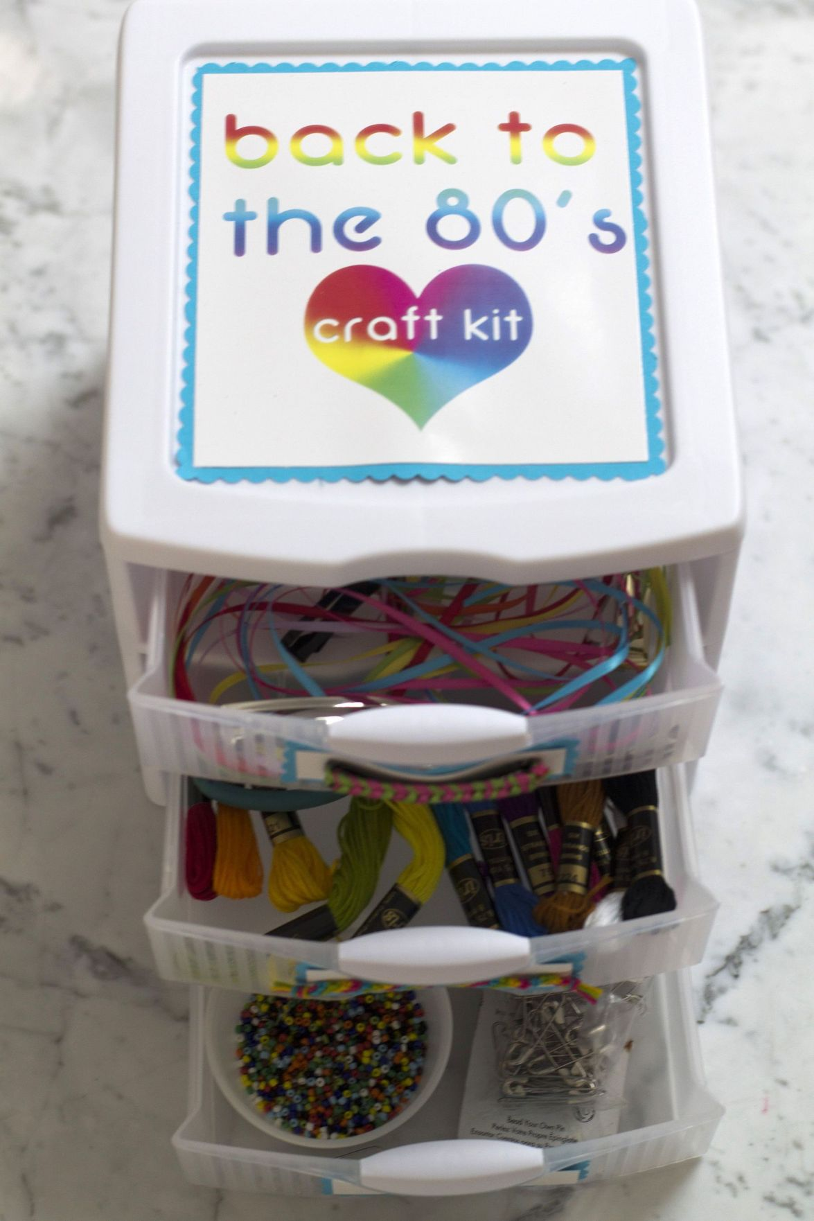 Supplies of pins, bracelets, barrettes fill 1980s-inspired kit