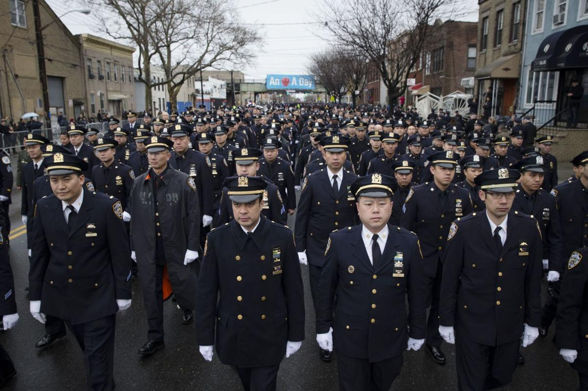 Thousands turn out for NYPD officer's funeral