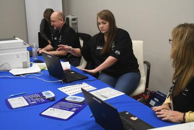 DMV members working to issue REAL IDs (copy)