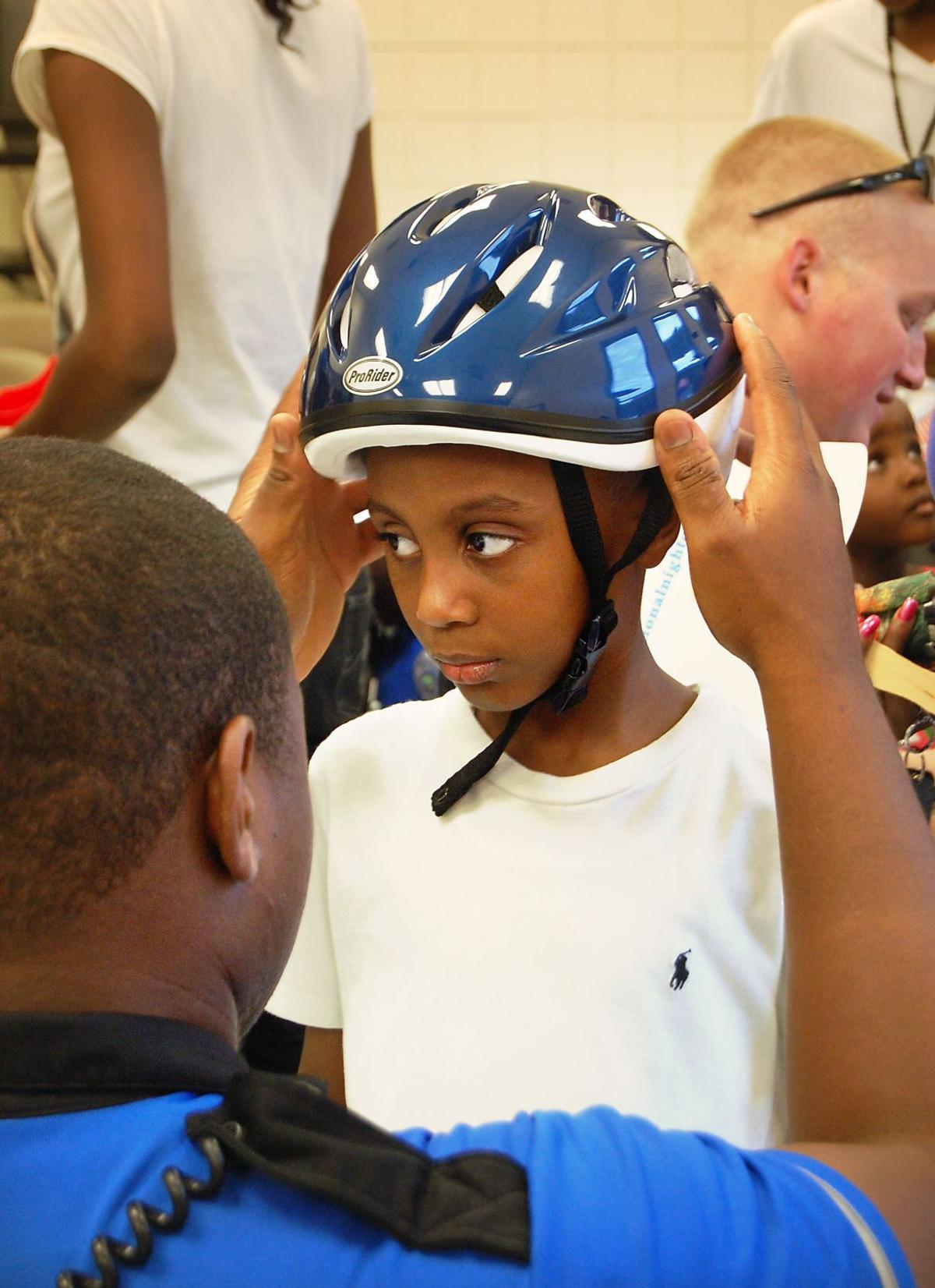 Law firm's brainy idea: free helmets for kids