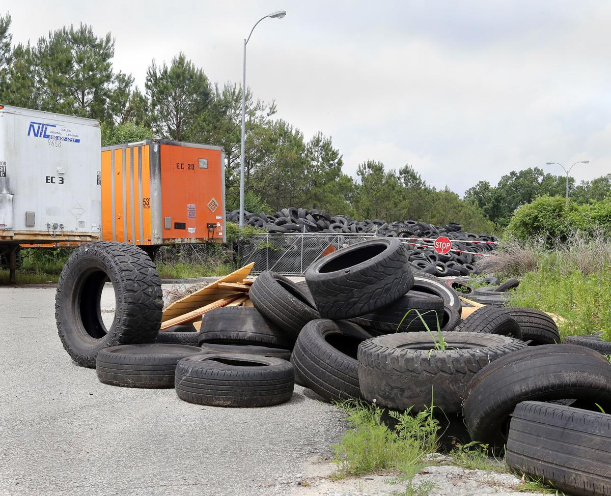 Residents next to giant South Carolina tire pile relieved but wary on flat tires, kenda tires, trailer tires, duplex tires, motorhome tires, snowmobile tires, row crop tires, fifth wheel tires, commercial tires, animals made from old tires, rental tires, garage made from old tires, tubeless bicycle tires, classic car tires, discount rv tires, co-op tires, single wide tires, moped tires,