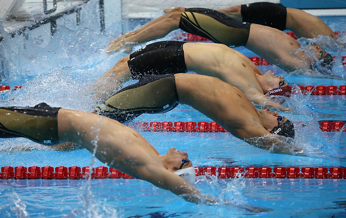 Backstroke golds for American pair at Olympics