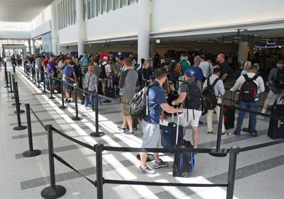 Airport suggests arriving early as holiday lines grow (copy)
