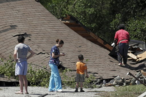 Twister damages schools, homes