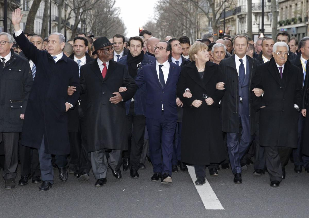 Millions jam streets in Paris, around world in historic rally for unity