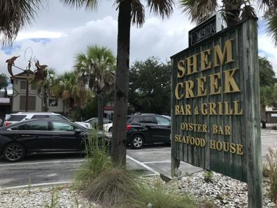 Shem Creek Bar & Grill sign by road