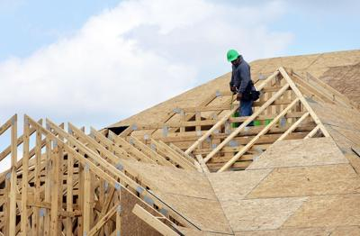 Carnes Crossroads worker on roof of house under construction (copy) (copy) (copy)