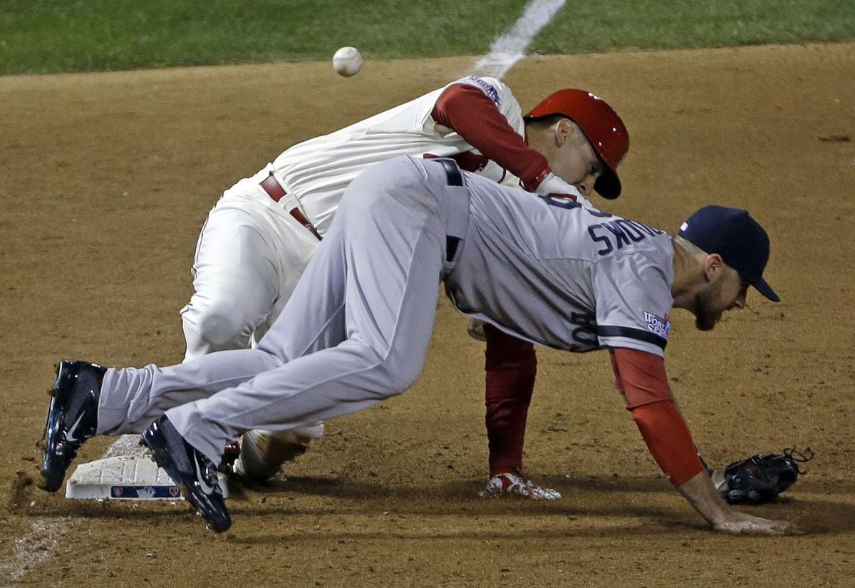 Obstruction call gives Cardinals win in Game 3
