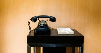 Retro telephone on a wooden table