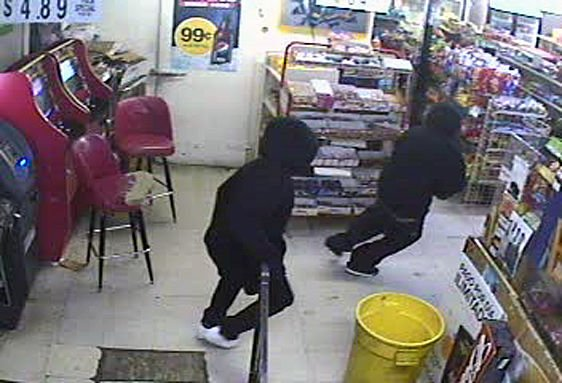 Police release photos of suspects robbing downtown store