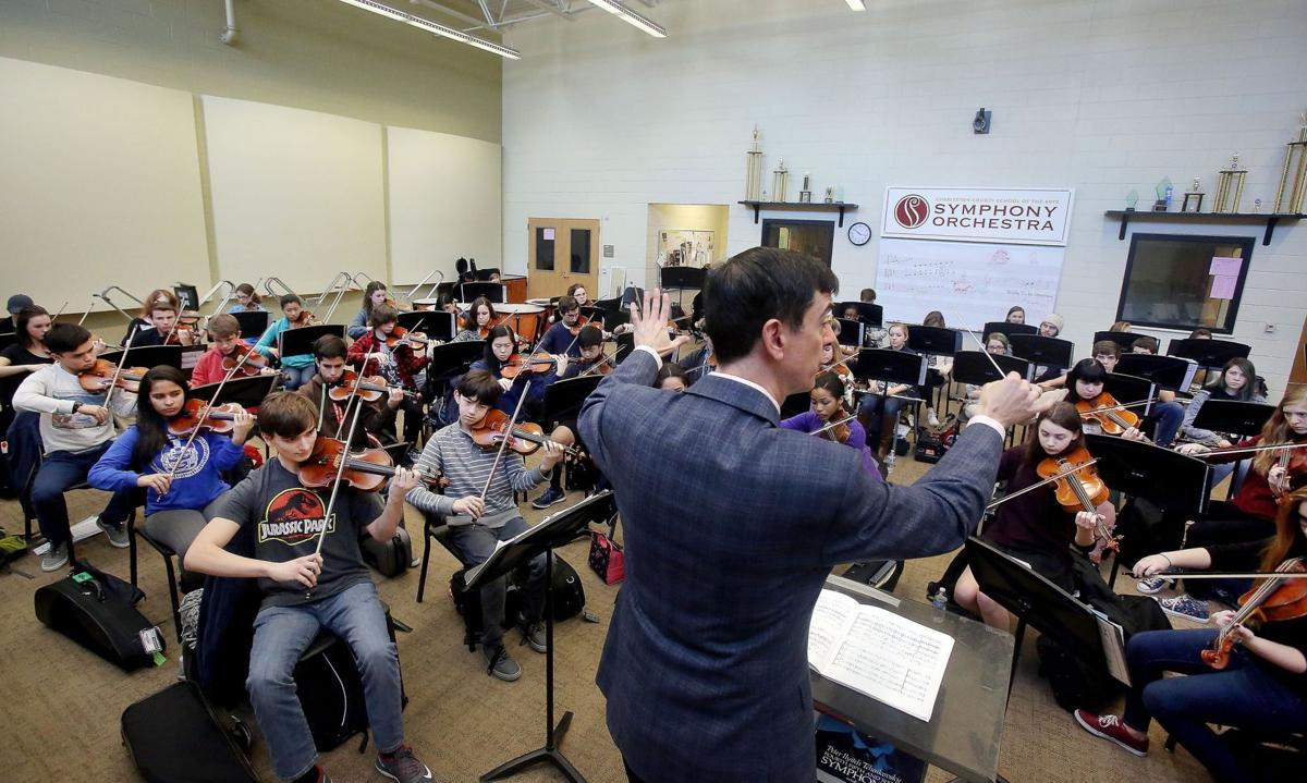 Student symphony orchestra raises the bar School of the Arts conductor sees 'potential for greatness'