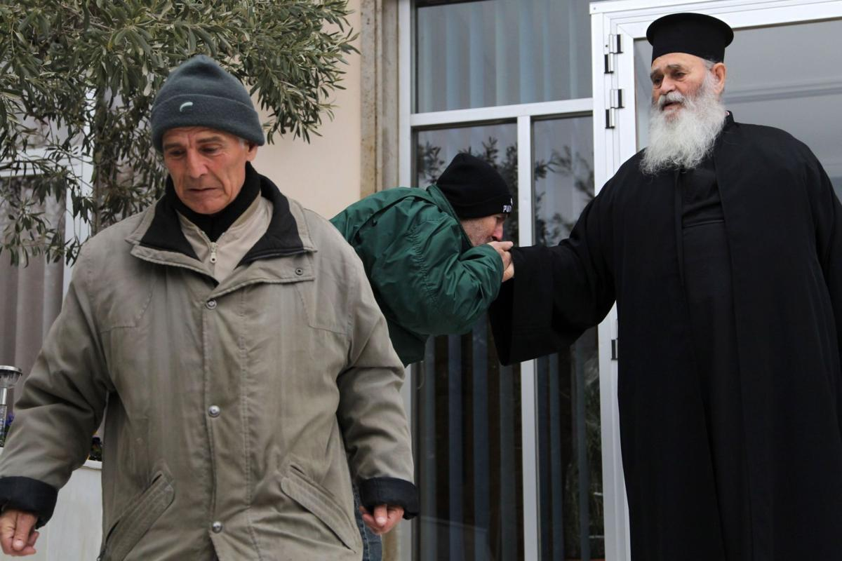 In Greek crisis, priest buys inmates their freedom