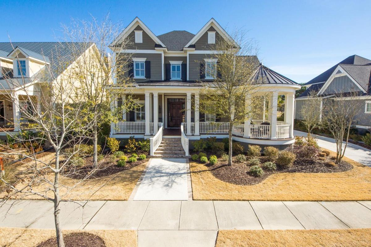 164 Ithecaw Creek St. — Course-side Daniel Island home incorporates attached gazebo, gourmet kitchen, incomparable deck views