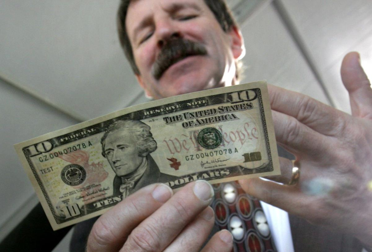 Why is 1st U.S. treasury chief leaving $10 bill?