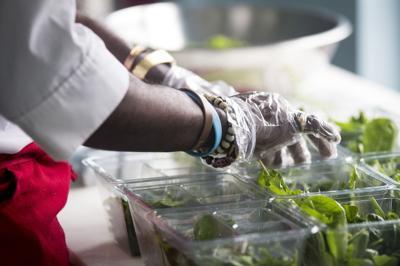 Rep. JA Moore preparing salad