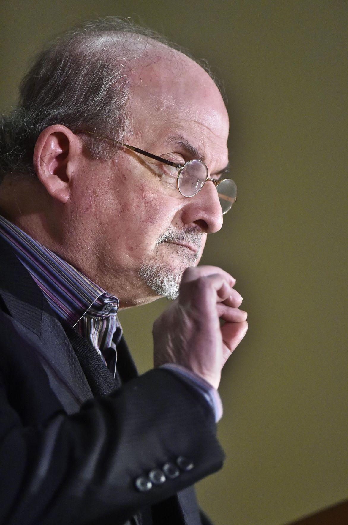 Rushdie, threatened over book, defends free speech