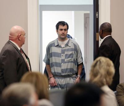 Slager files suit over legal defense