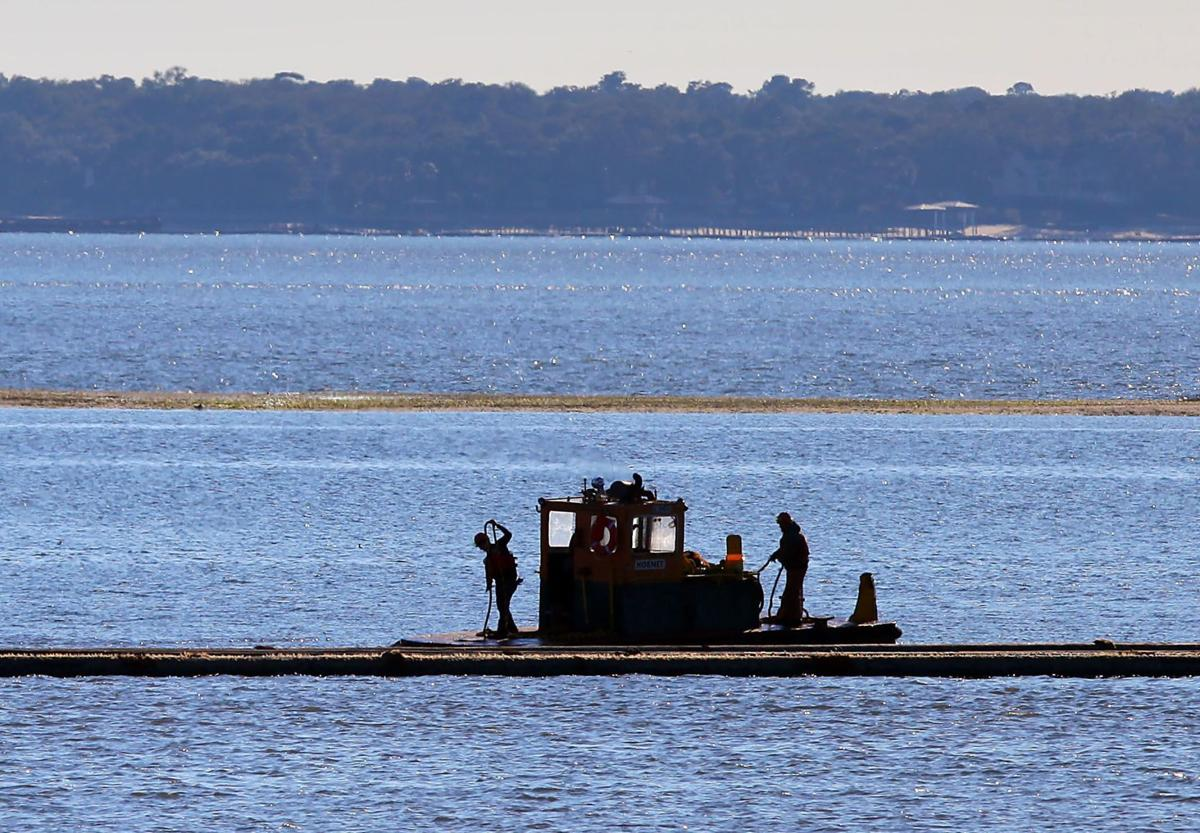 Running the pipline; dredging in harbor area calls for boater caution