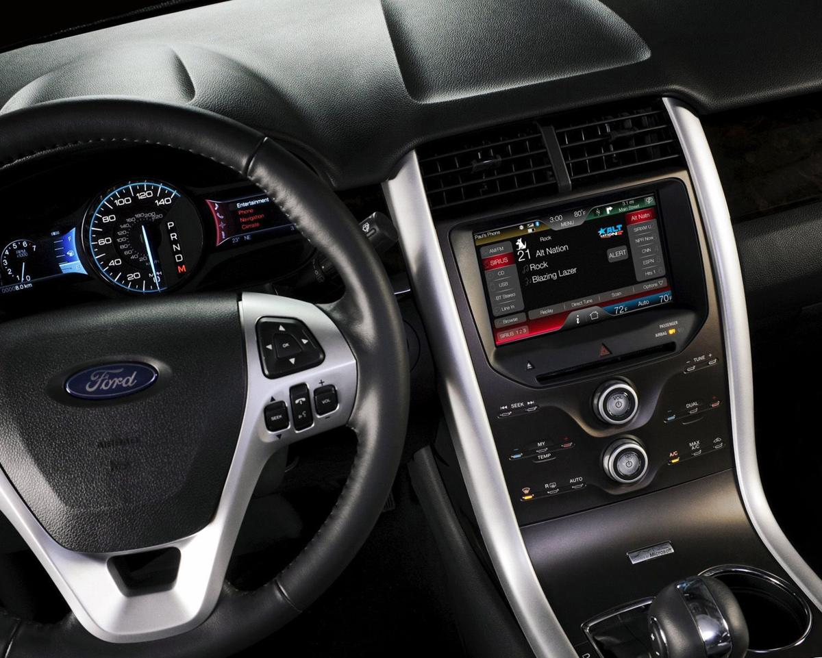 Getting Gadgety: Automakers installing high-tech baubles to upgrade car-riding choices, lure shoppers