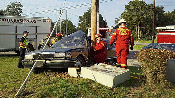 Police chase ends with car wrapped around utility pole