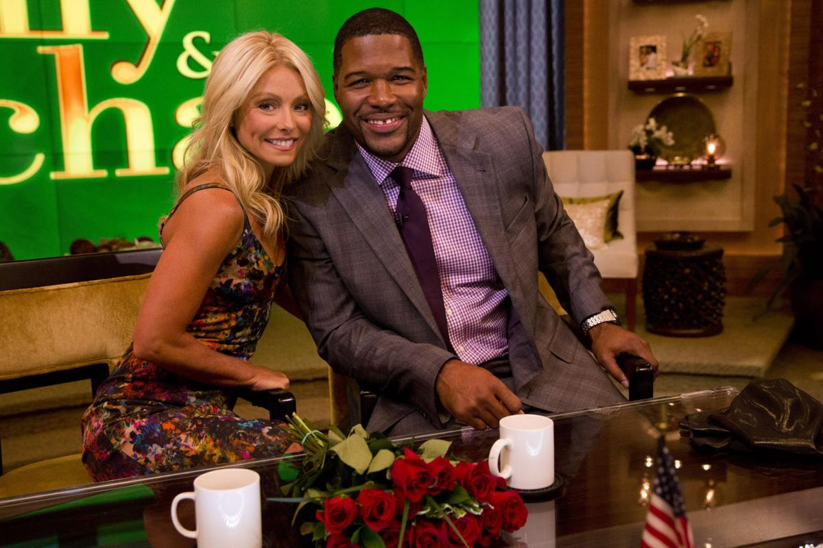 Ex-NFL star Strahan officially joins Kelly