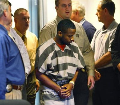 Suspect charged in triple slaying