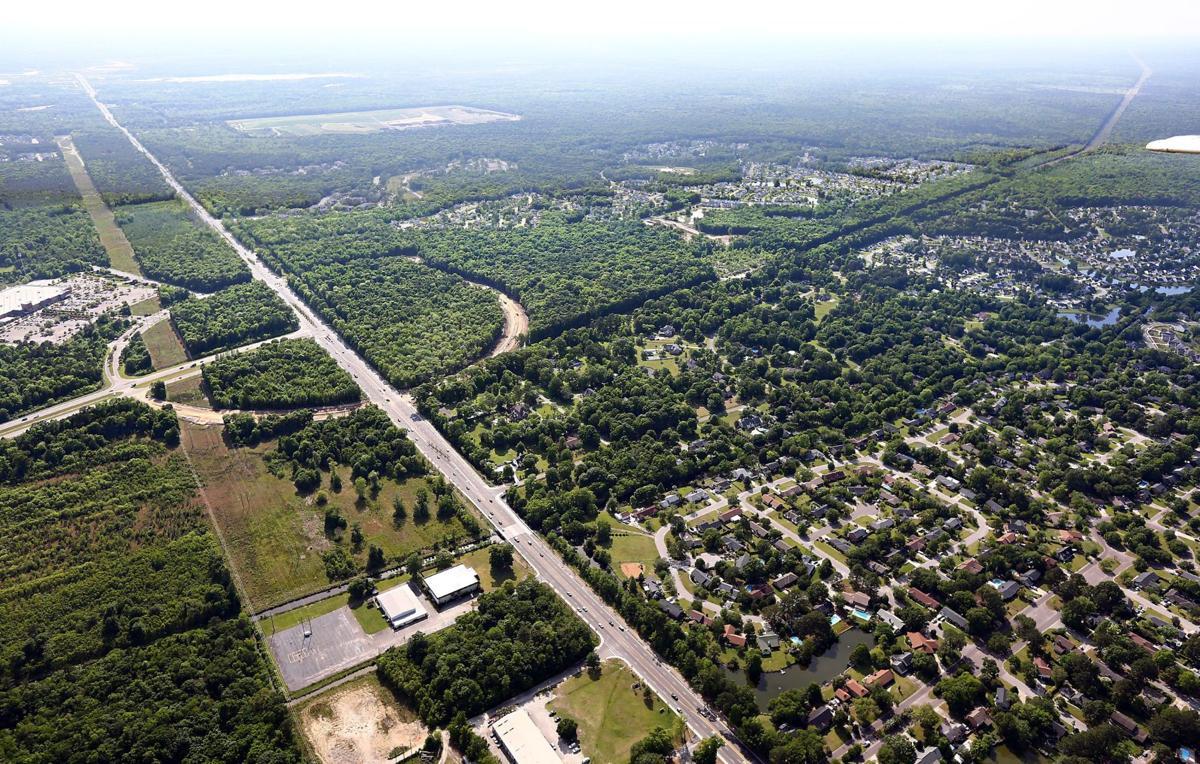 Longer parkway may form gateway Four-lane would cross Long Savannah project