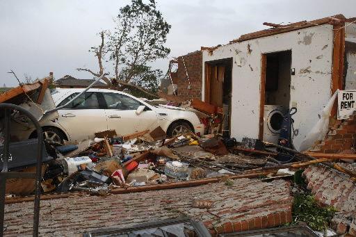 Violent storms kill 13 in Okla., Kan., Ark.