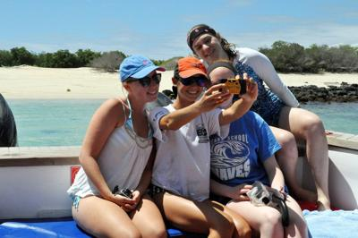 Teens love vacation selfies; many adults, not so much