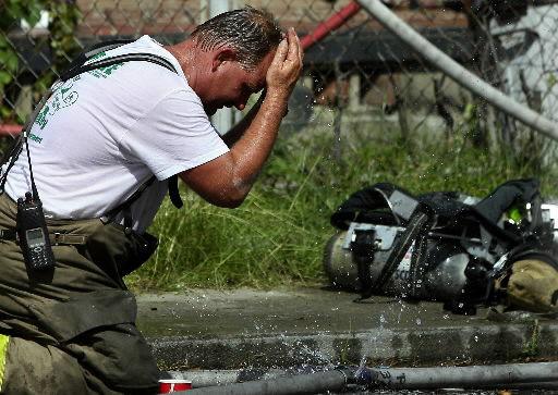 Firefighters battle fire, summer heat