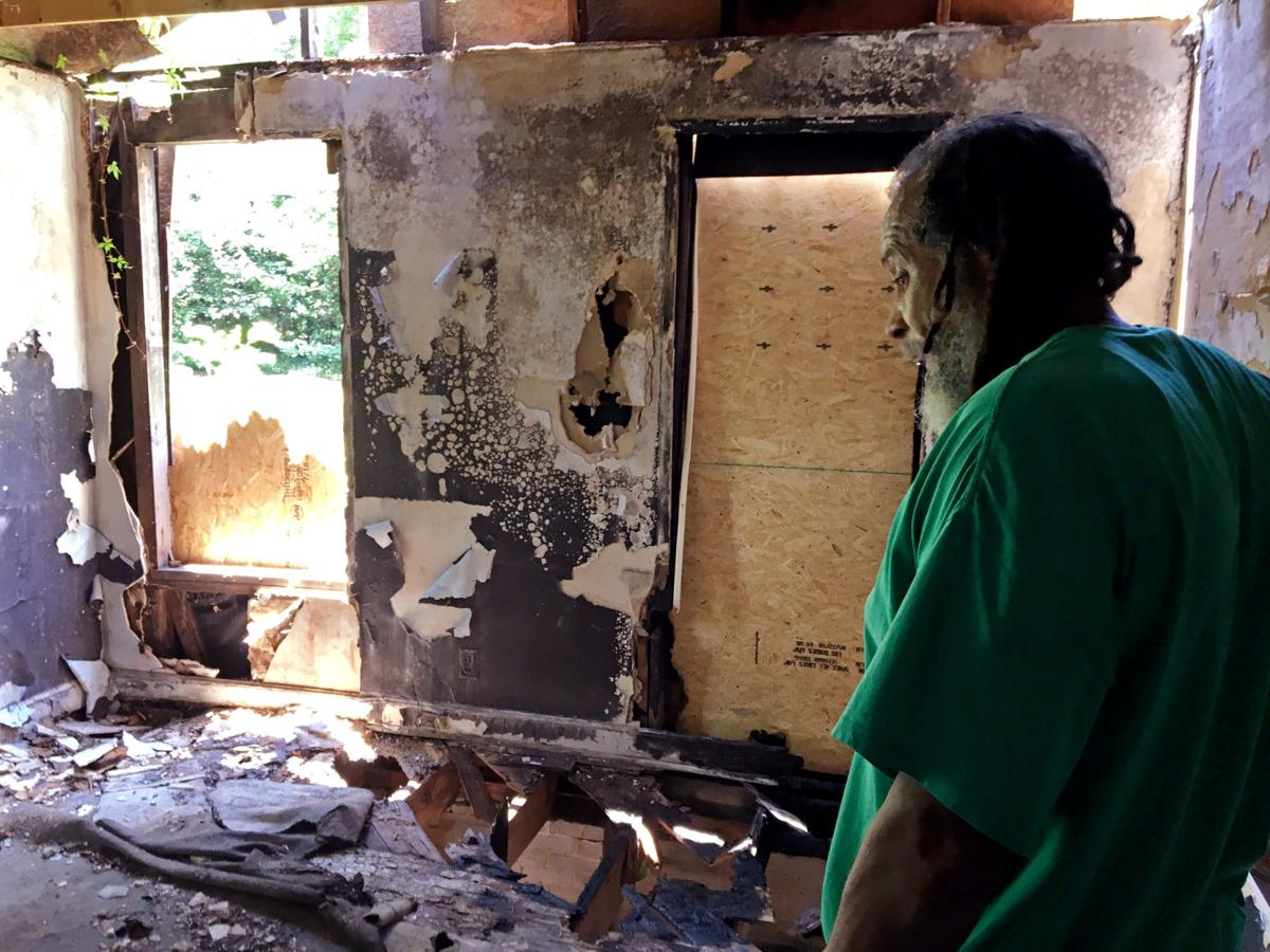 Burned-out houses in Columbia stoke fear for African American area