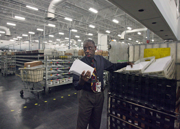 North Charleston postal center pushes through tons of mail