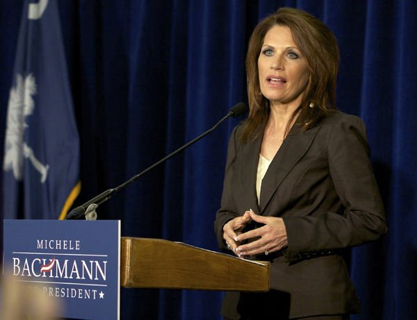Bachmann signs 'Cut, Cap and Balance': During stop in Columbia, invokes DeMint views on pledge
