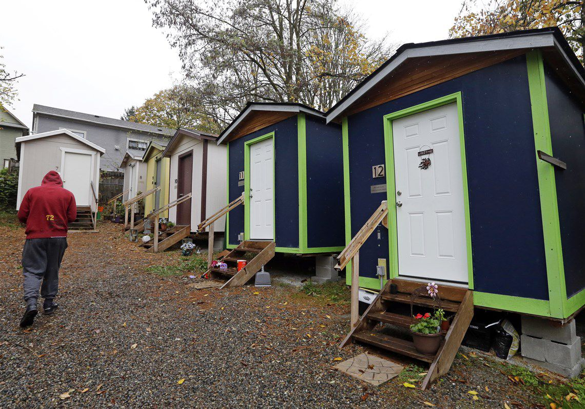 This Row Of Tiny Houses Is At A Homeless Encampment In Seattle Behind Conventional Homes Elaine Thompson AP