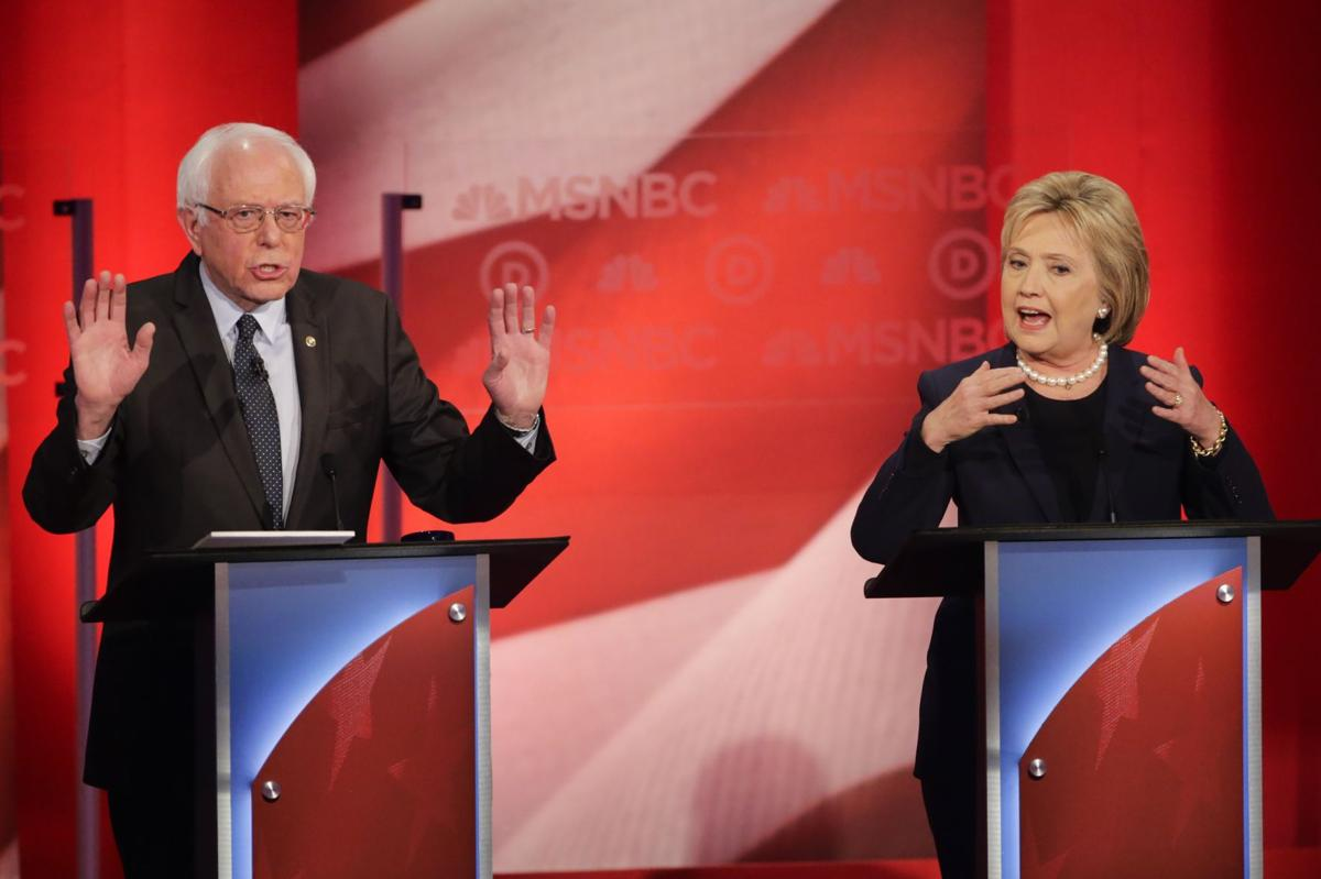 Dems up the decibels in NH debate; Wall Street a common foe