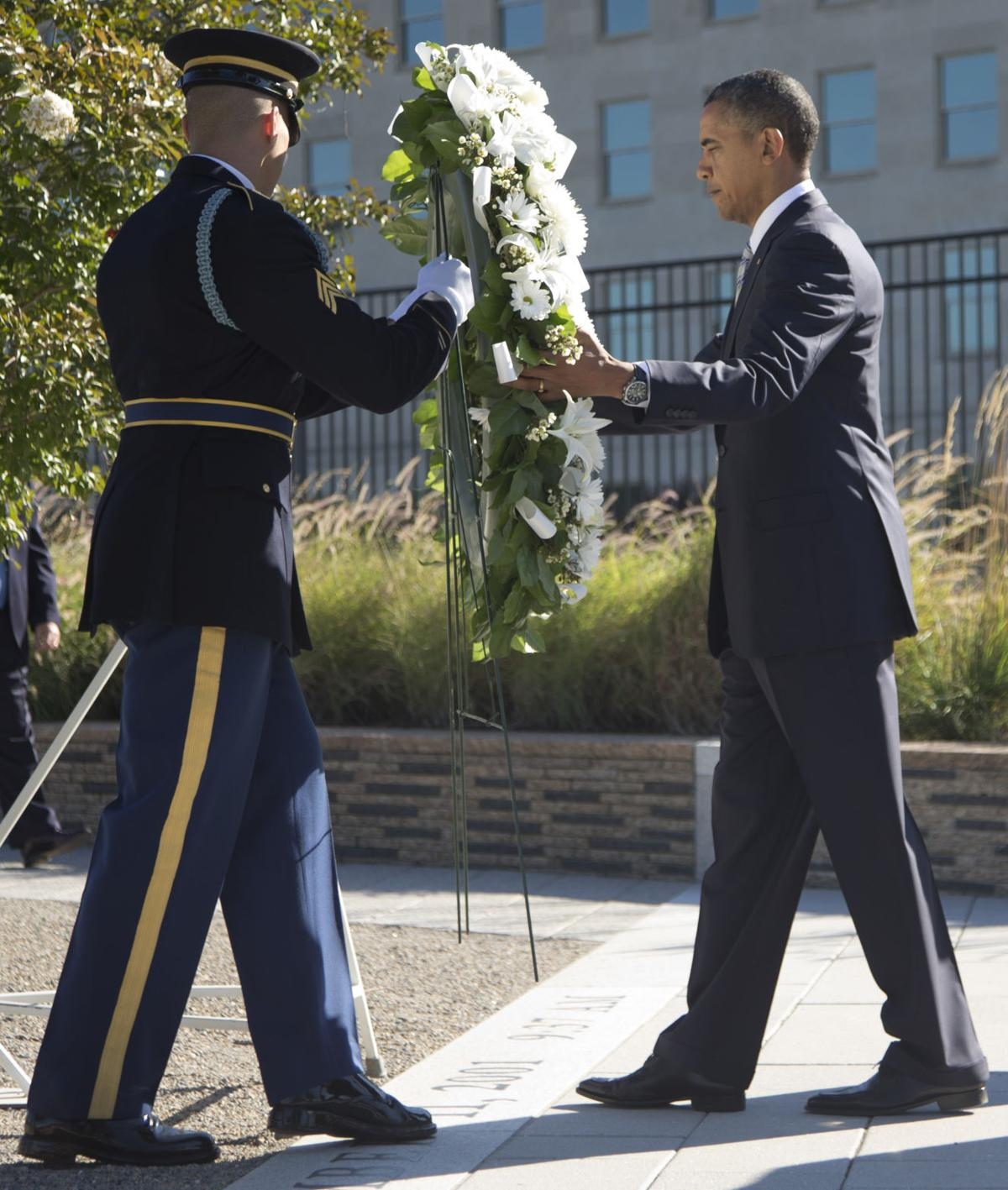 'We'll always remember'Smaller ceremonies on 11th anniversaryPartisan jibes absent for 9/11, but not politics