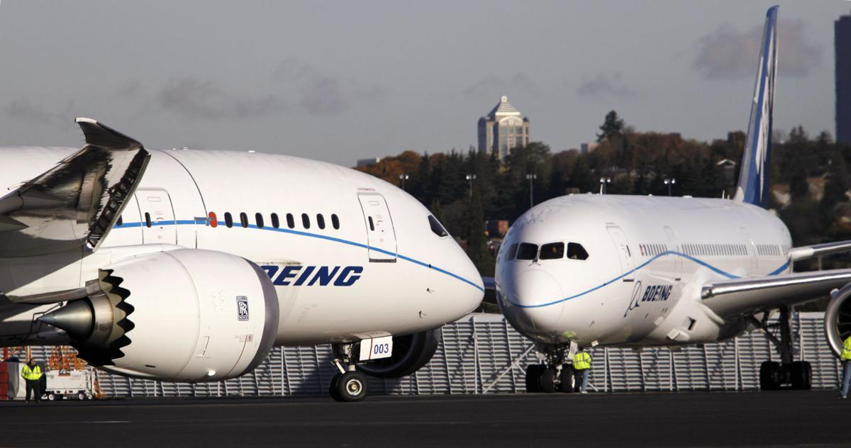 Boeing warns it will take $2.05B hit