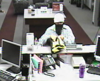 Robber leaves suspected bomb