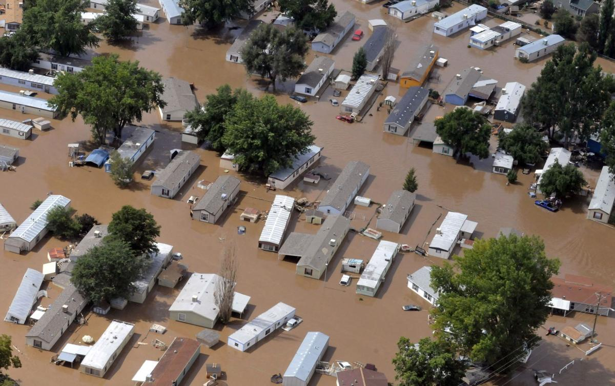 Colorado towns cut off by flooding slowly begin clean up as search and rescues continue