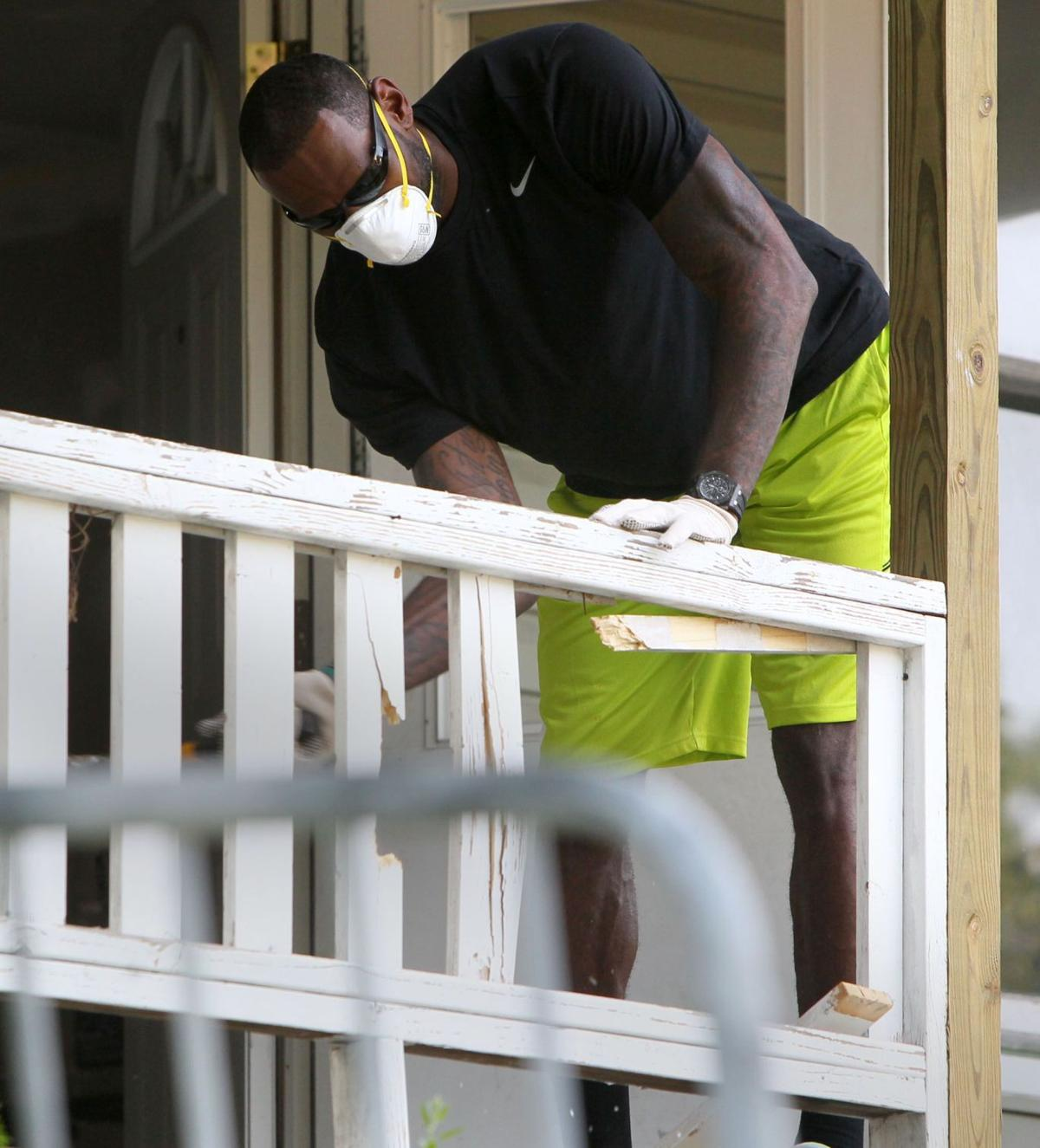 LeBron, sons pitch in on Akron, Ohio, home rehab