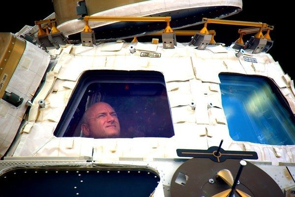 2 astronauts back home after year aloft: 'We did it!'
