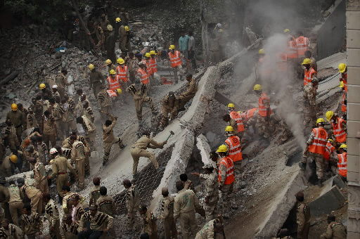 Building tragedies hit China, India; 119 killed
